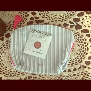 Ipsy bag with makeup.